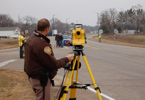 Detective Meidl Conducts Crash Scene Survey at the Scene of a Fatal Car Crash